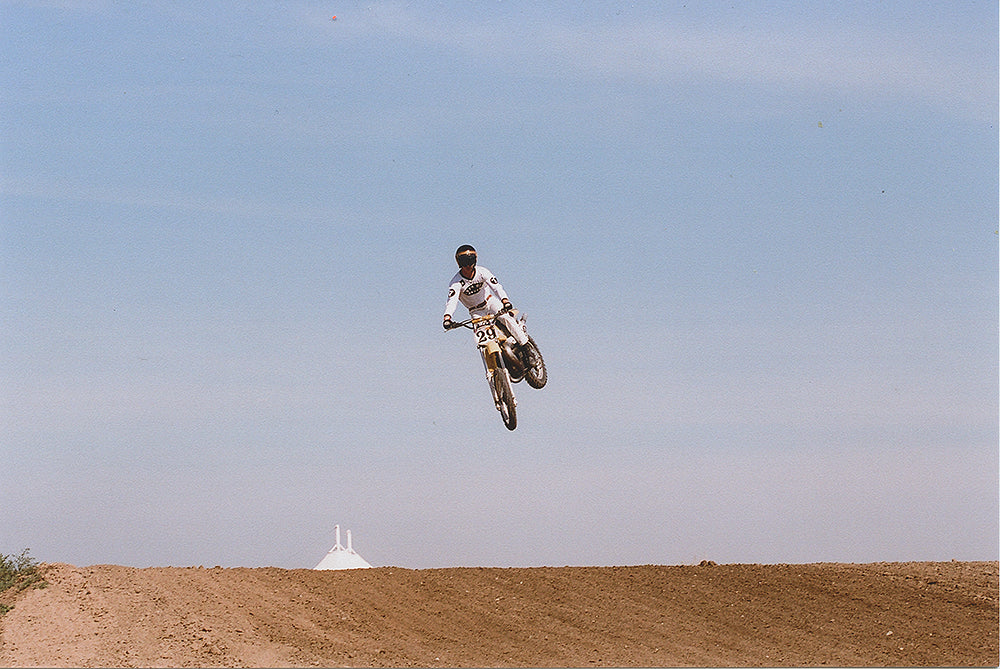 mx rider doing a jump on a motorcylce