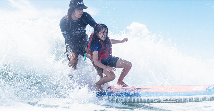 tandem surfing at the surfers healing event