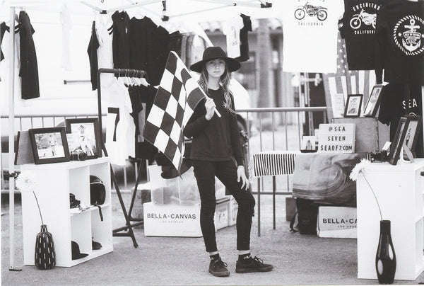 eden english at del mar fair the born free show holding a checkered racing flag