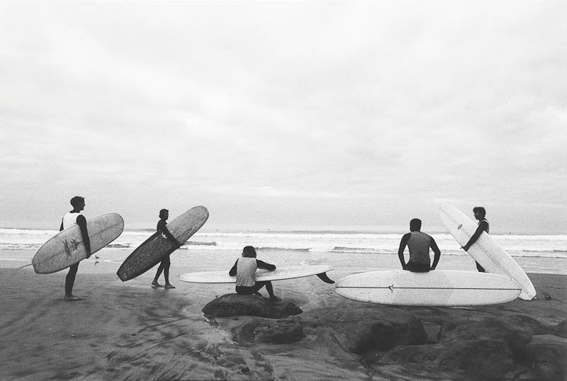 Group of long boarders on the beach at Del Mar 15st ready for their surfing heat.