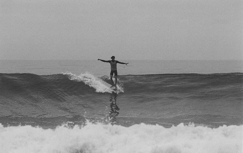 River Covey hanging ten on his longboard in Del Mar 15st California.