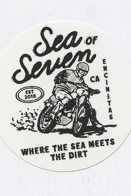 where the sea meets the dirt sticker with a guy on a motorcycle by sea of seven