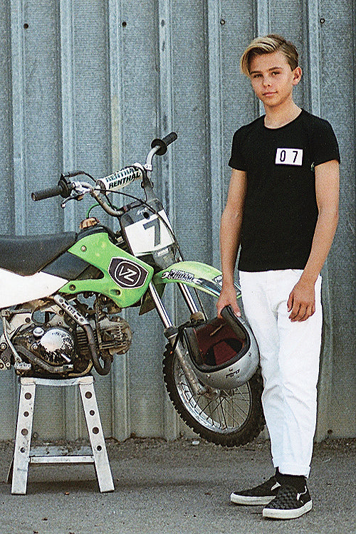 Boys black tee with 07 on front and the back a dirt bike mx with ENCINITAS CALIFORNIA t-shirt