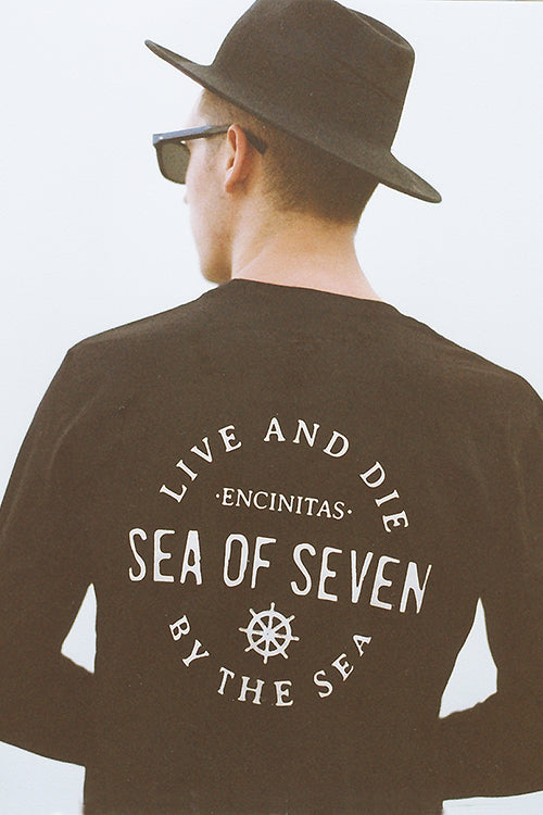 Live And Die By The Sea black mens longsleeve tshirt by Sea Of Seven in Encinitas