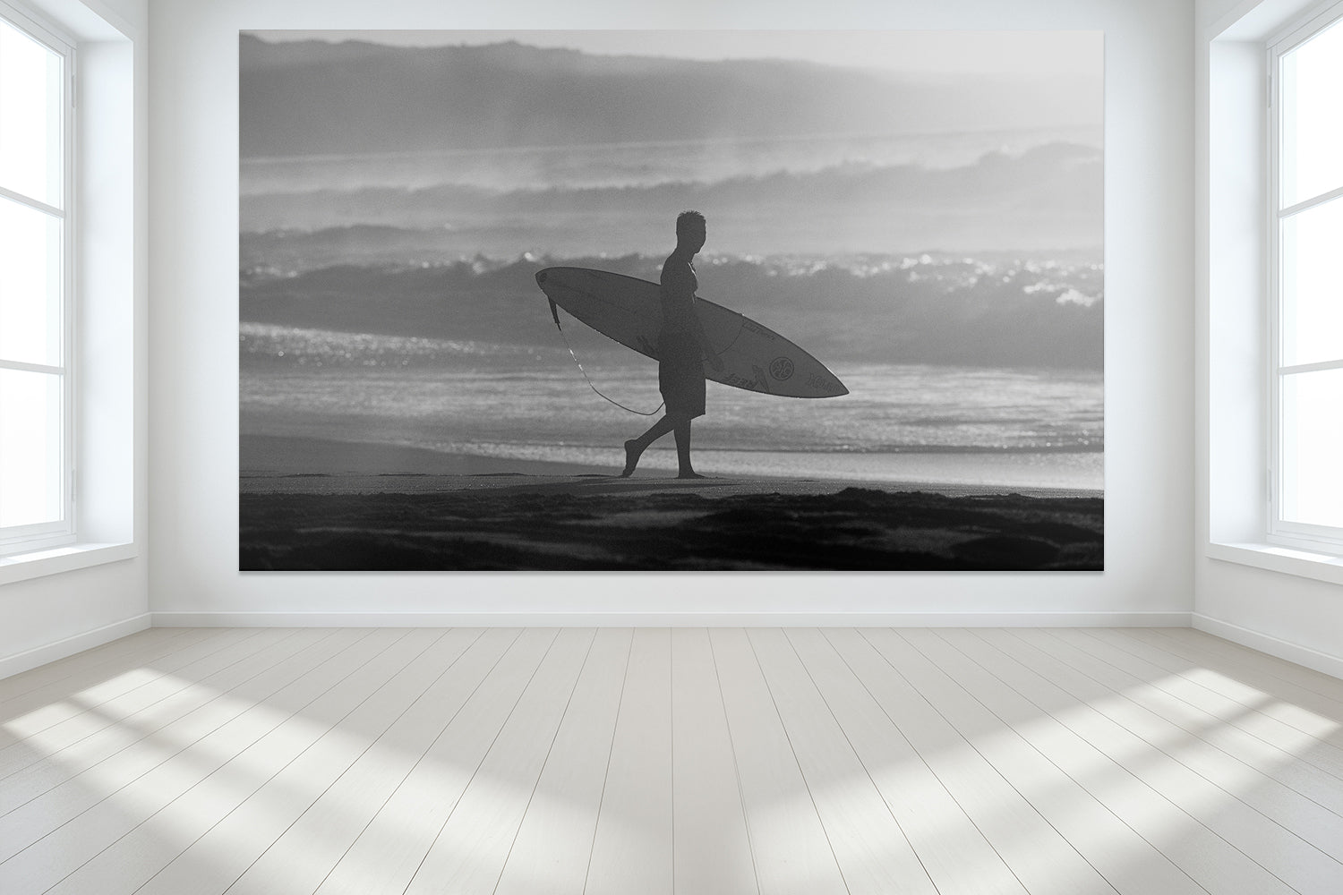 Surfing wall murals from Hawaii of a surfer walking on the beach on the North Shore of Oahu.