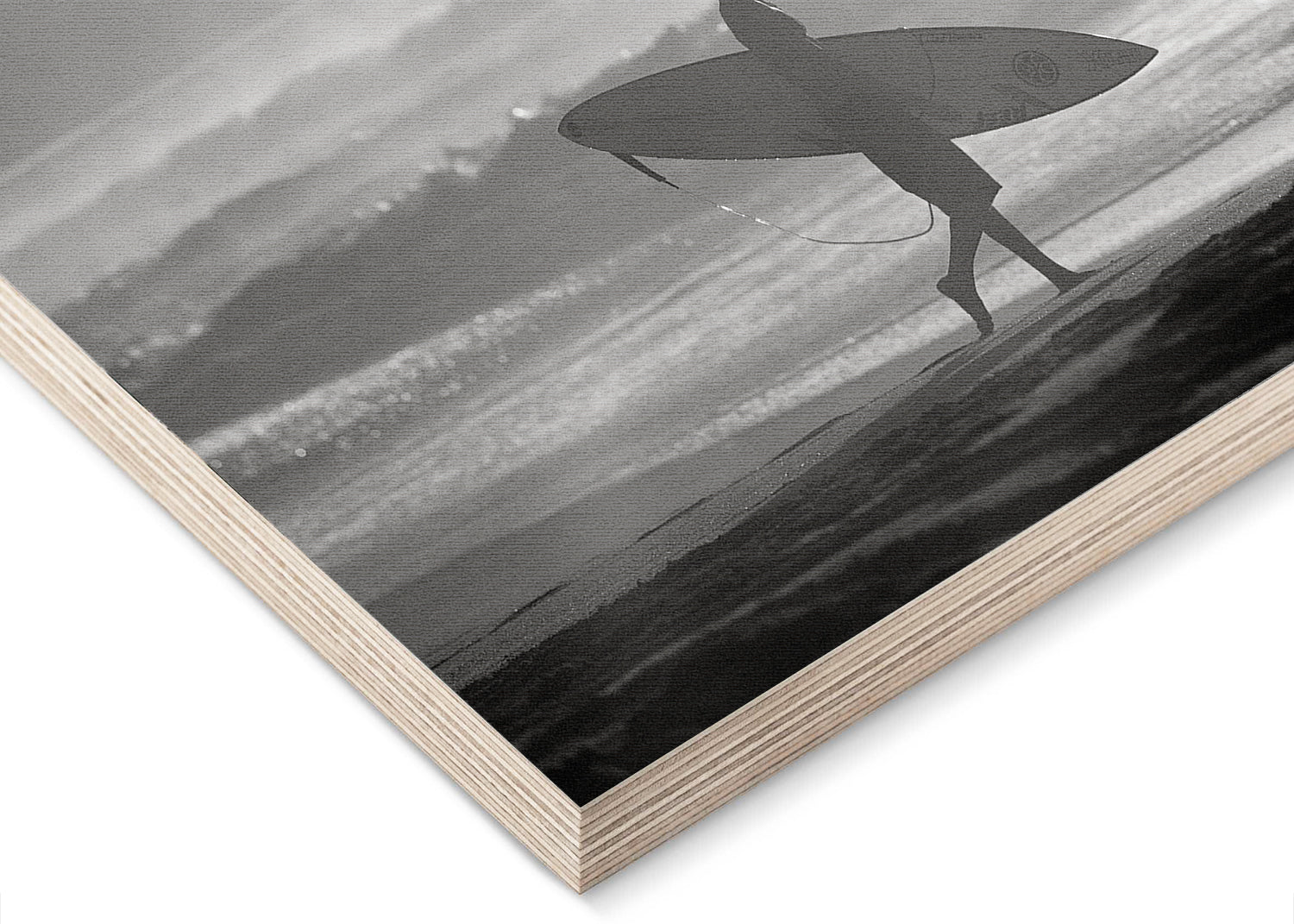 Surfer walking on beach holding surfboard black and white at Off The Wall on the North Shore of Oahu in Hawaii wood print