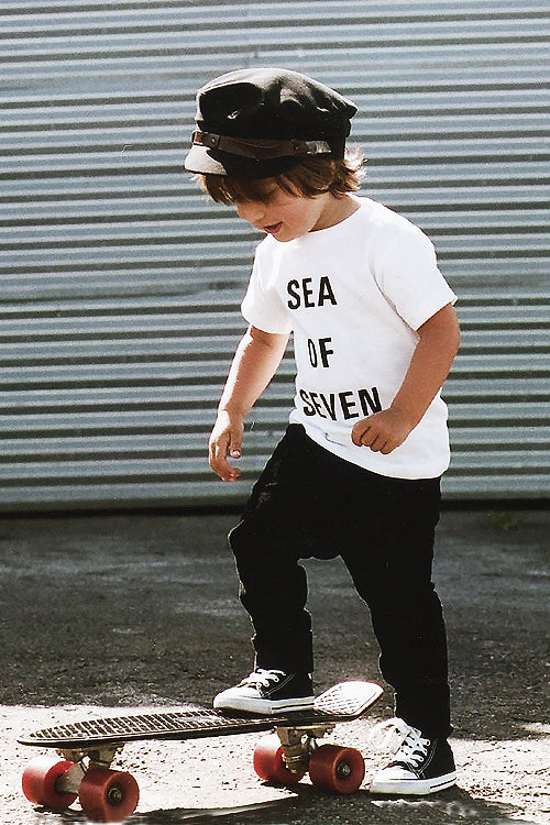 Sea Of Seven toddler model River English wearing Next Hero tee, Fallen Broken Street fiddler cap, Zara pants and Vans shoes.