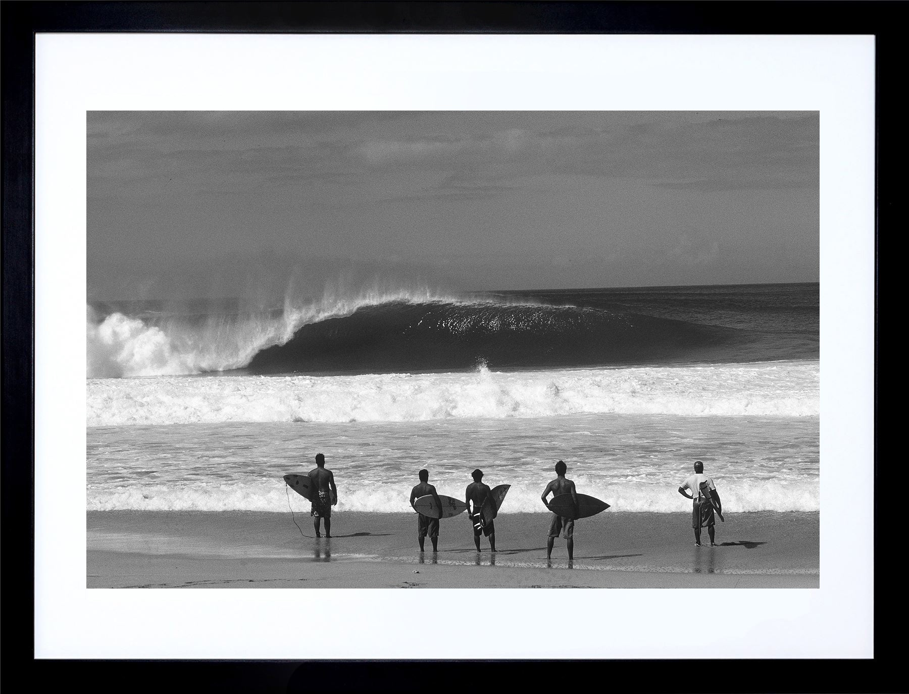 Standing Room Only gallery quality surfing prints of an empty wave at Pipeline on the North Shore of Oahu with a row of surfers standing on the beach holding their surfboards.