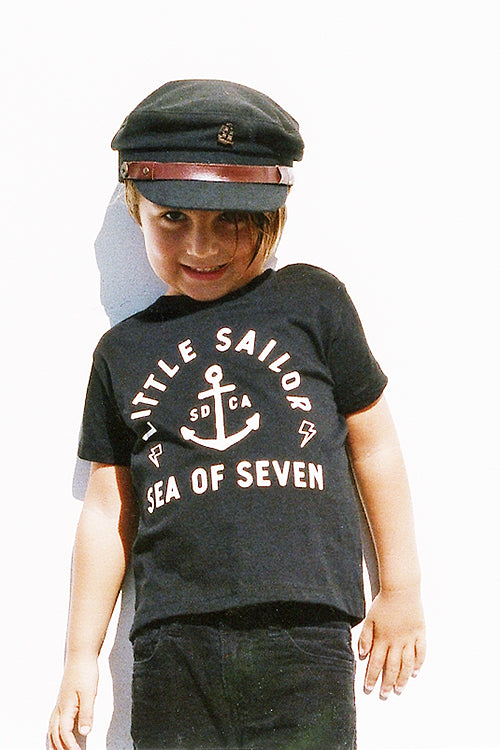 Boy toddler wearing Little Sailor black short sleeve tee with ship anchor and lighting bolts