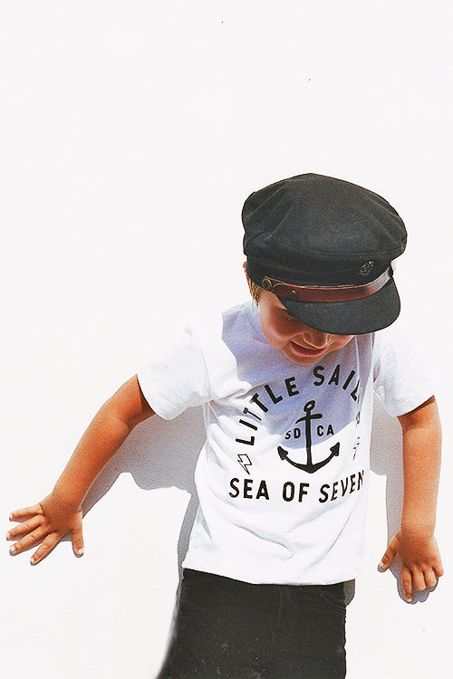 Little Sailor white short sleeve boys tee Fallen Broken Street toddler cap and Zara pants.