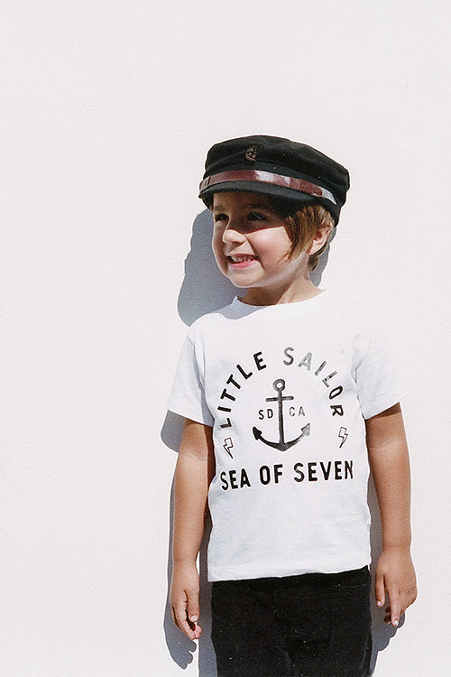 White toddler boys tee Little Sailor with ship anchor and lighting bolts.