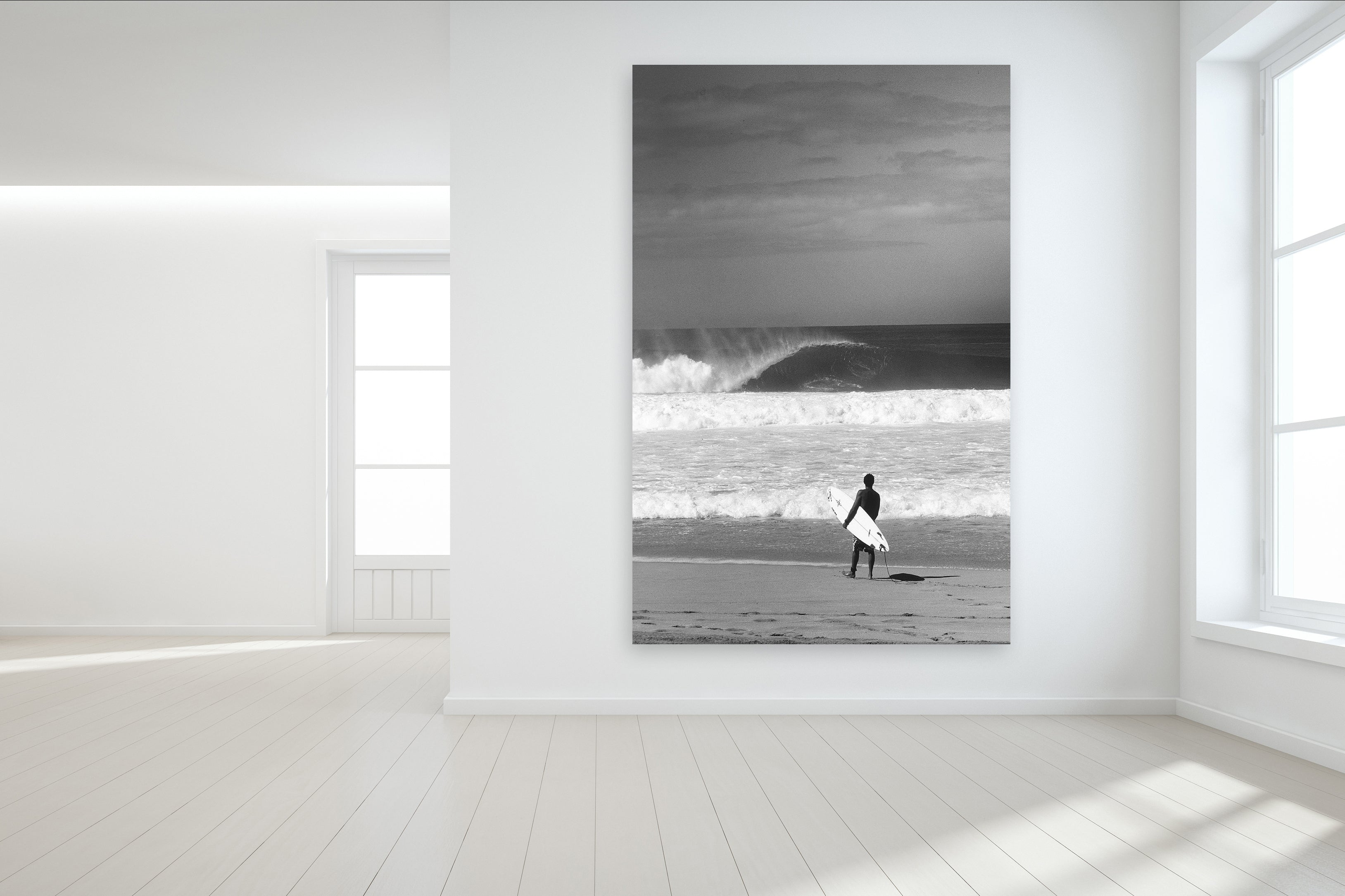 Surfing Wall Mural of a surfer standing on the sand at Pipeline on the North Shore of Oahu in Hawaii and custom surf wallpaper available.