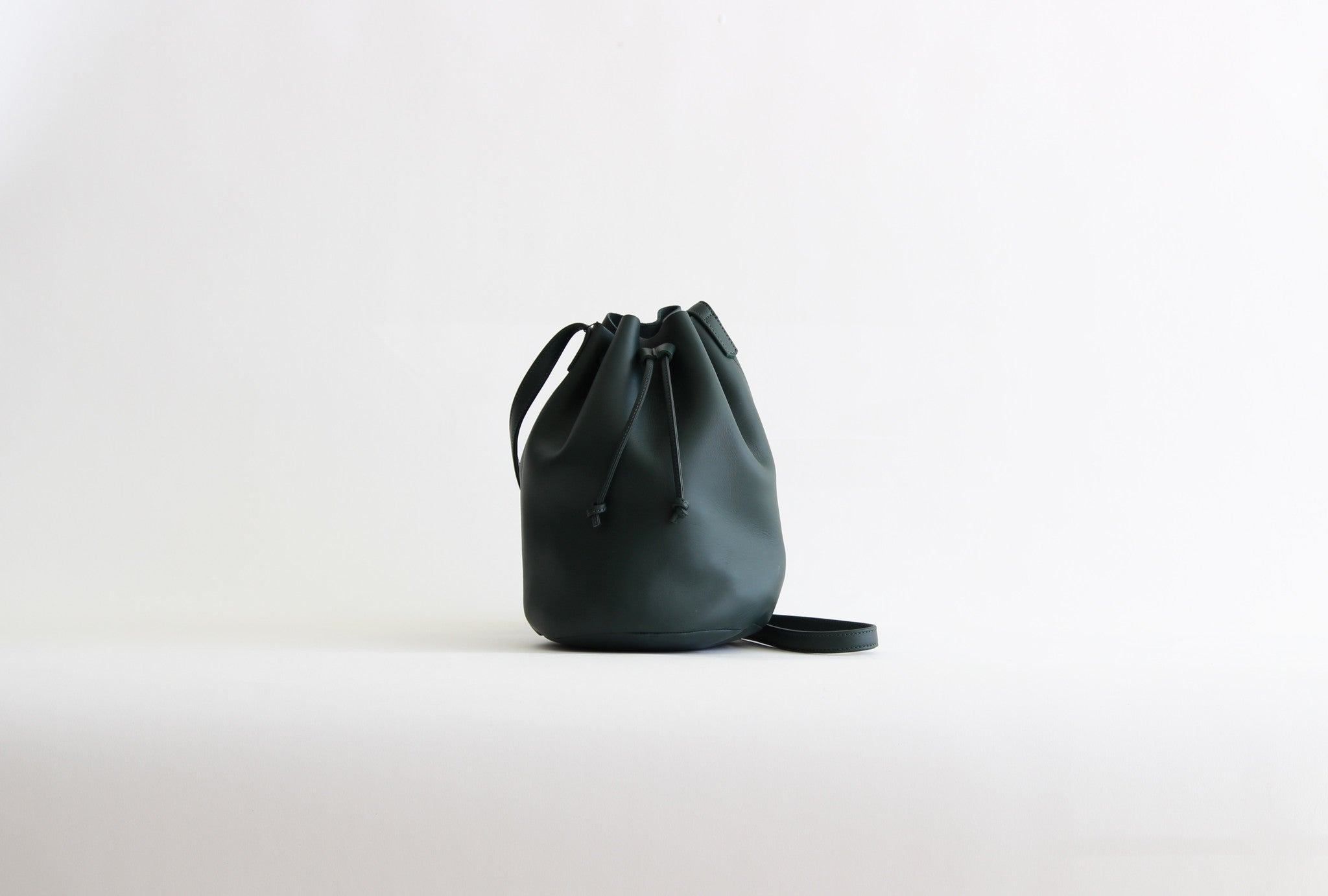 baggu leather drawstring bag dark green palm purse