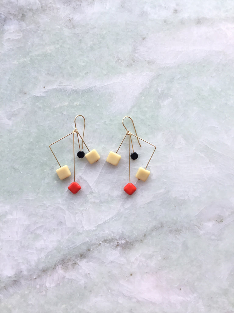 I.  Ronni Kappos cream, orange, black mobile earrings
