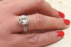 14K rose gold and white topaz engagement ring