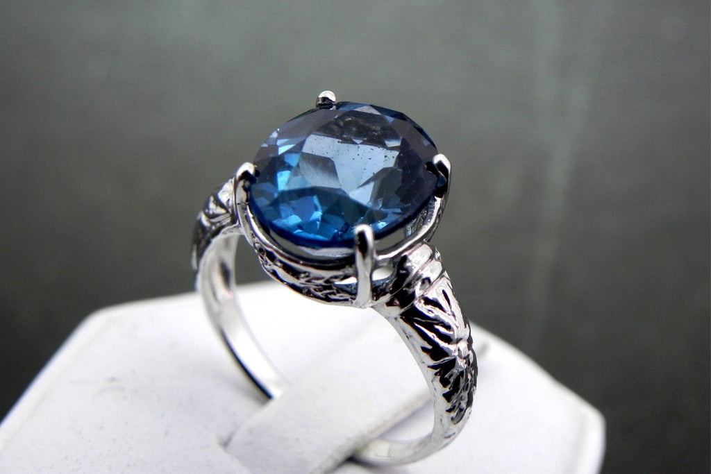 12x10mm 6 carat London Blue Topaz set in an Antique styled Sterling Silver Ring