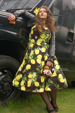 Lois hearts and roses lemon dress posing by a car