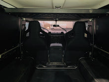 Defender upper cargo rack/storage shelf