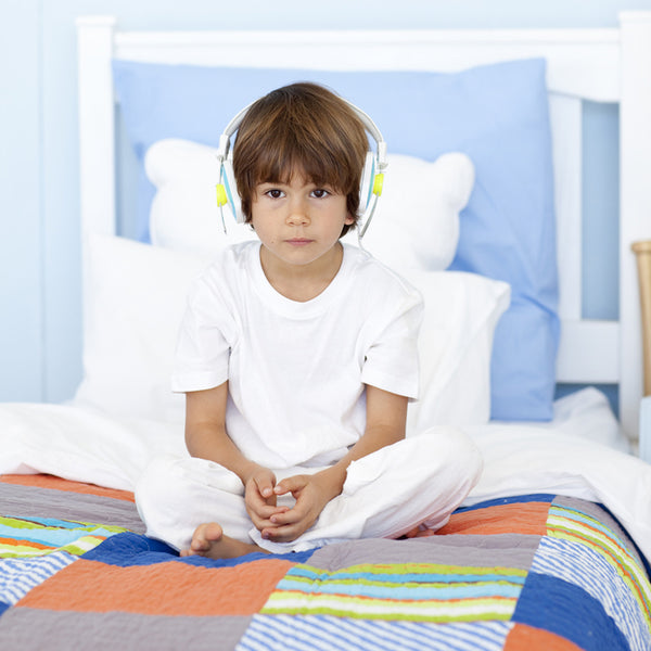 At what age should my child stop wetting the bed?