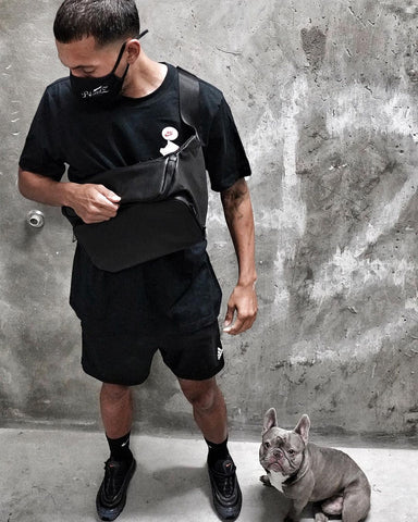 criztofferson wearing the byapptonly sidekick professional barber bag sling crossbody and puppy