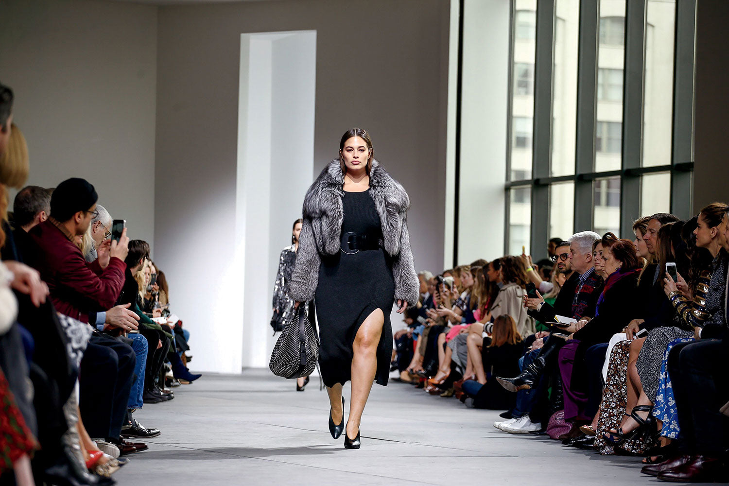 Ashley graham plus size inclusive model on the runway in Michael Kors
