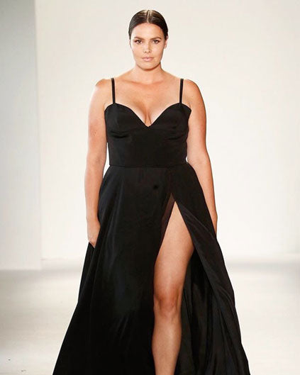 Candice Huffine walks the runway for Christian Siriano