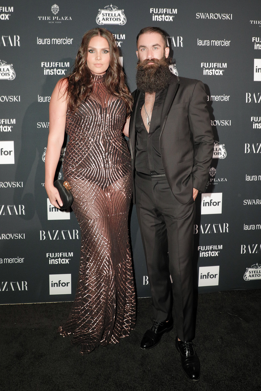 Candice Huffine and Matt Powers at the Harper Bazaar Icons party Wearing Christian Siriano