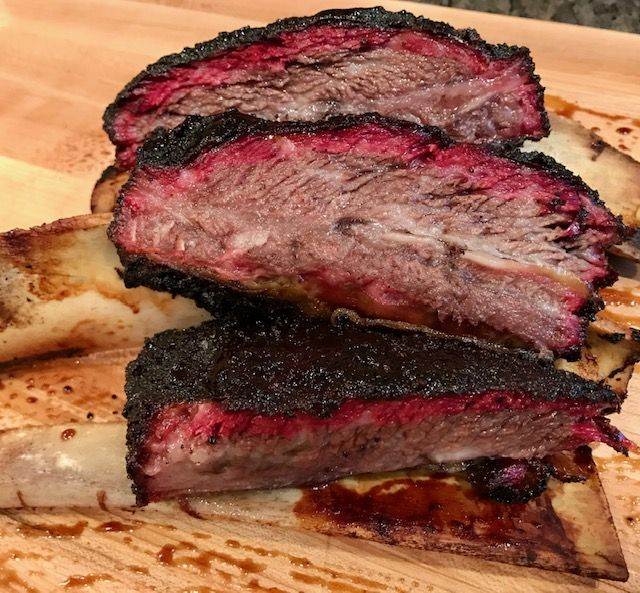 sliced up smoked beef short ribs showing a red smoke ring
