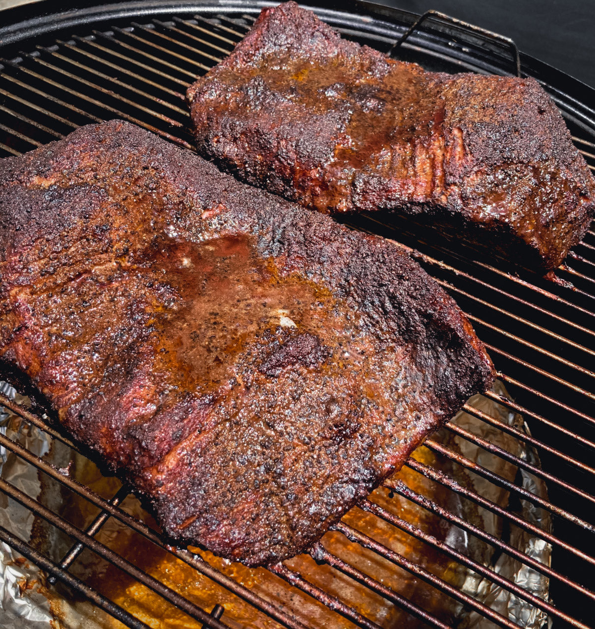 Photo of fully cooked briskets on a smoker