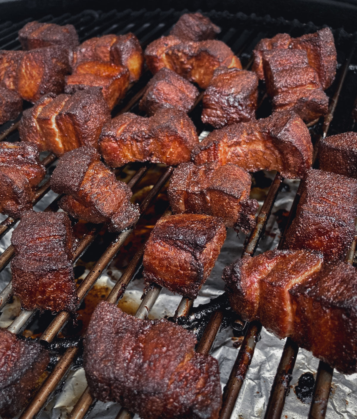 Photo of smoked pork belly burnt ends covered in bbq flavored dry rub