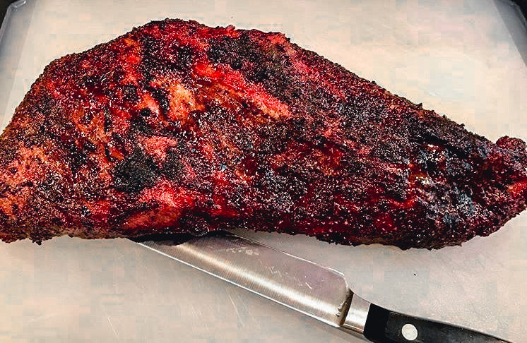 Photo of cooked tri-tip steak on a cutting board