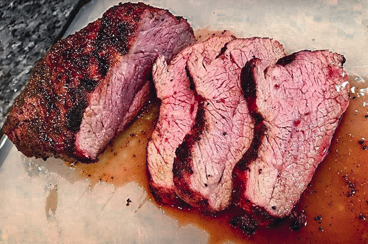 Photo of cooked and sliced tri-tip steak