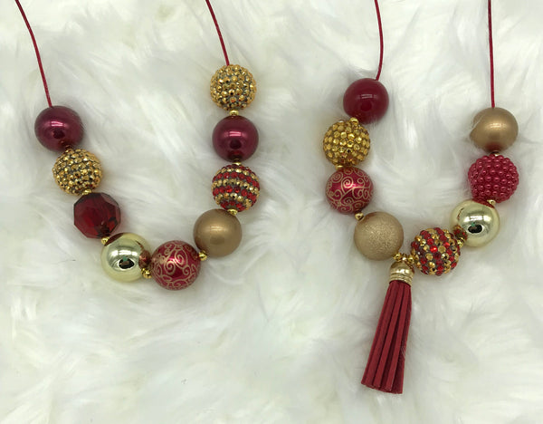 Gold and cranberry breakaway necklaces