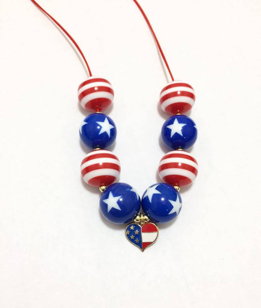 Red, white and blue with heart pendant