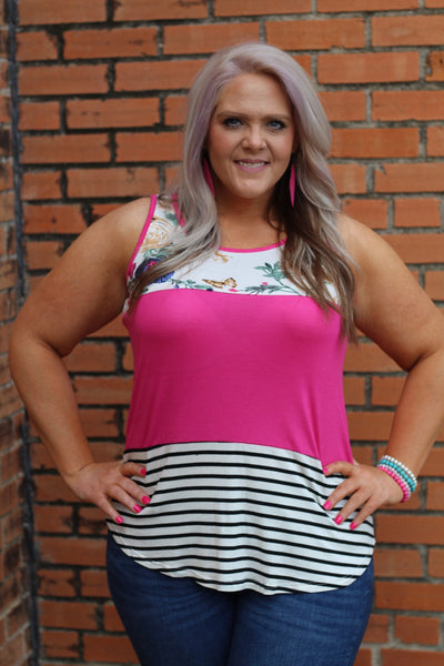 Beautiful hot pink color block tank featuring stripes and florals. Fits true to size.