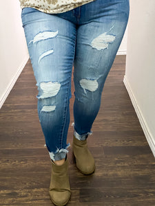 Medium Wash Mid Rise Skinny Jeans with Distressing