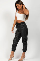black faux leather joggers with purse and utility belt