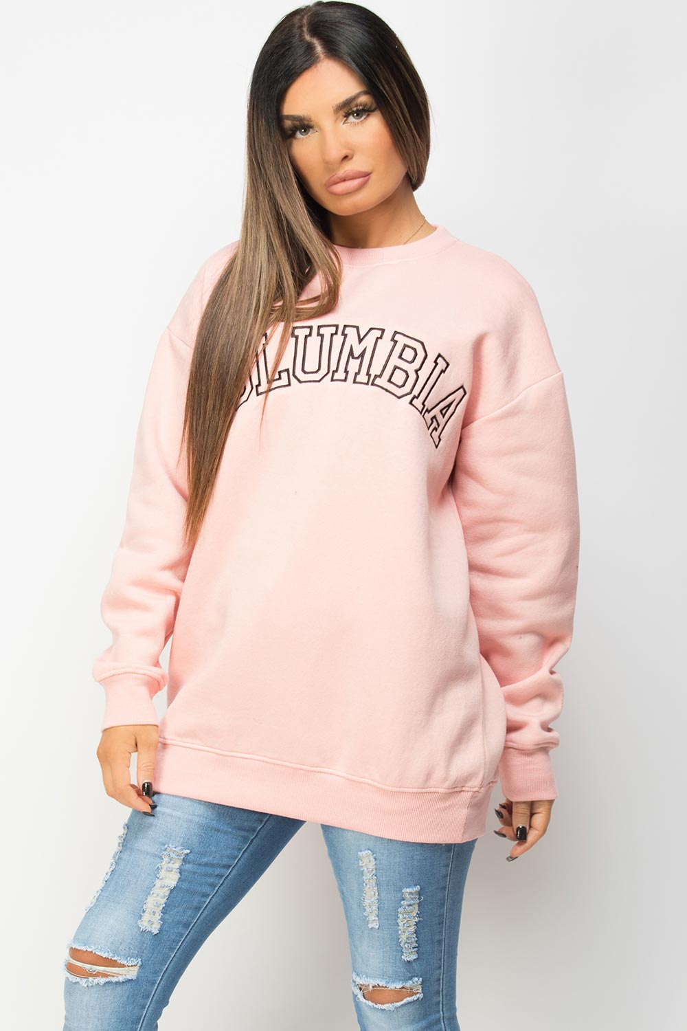 pink sweatshirt with cloumbia slogan styledup fashion