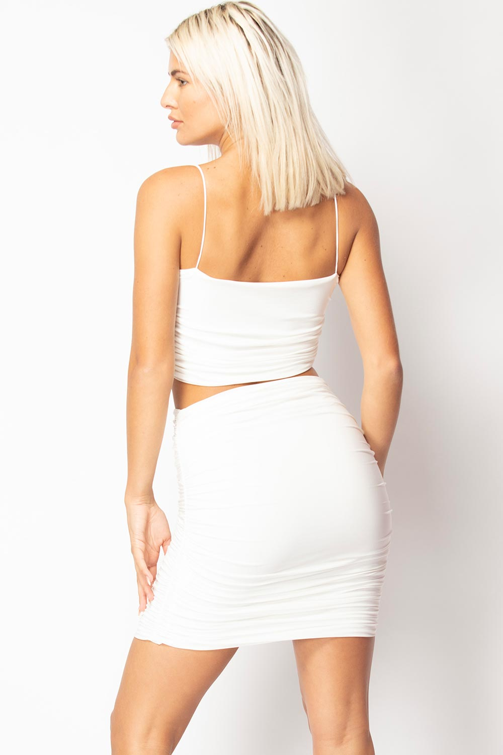 cream crop top and ruched skirt set
