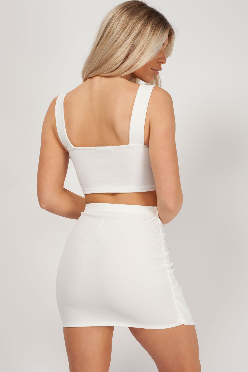white two piece skirt and top