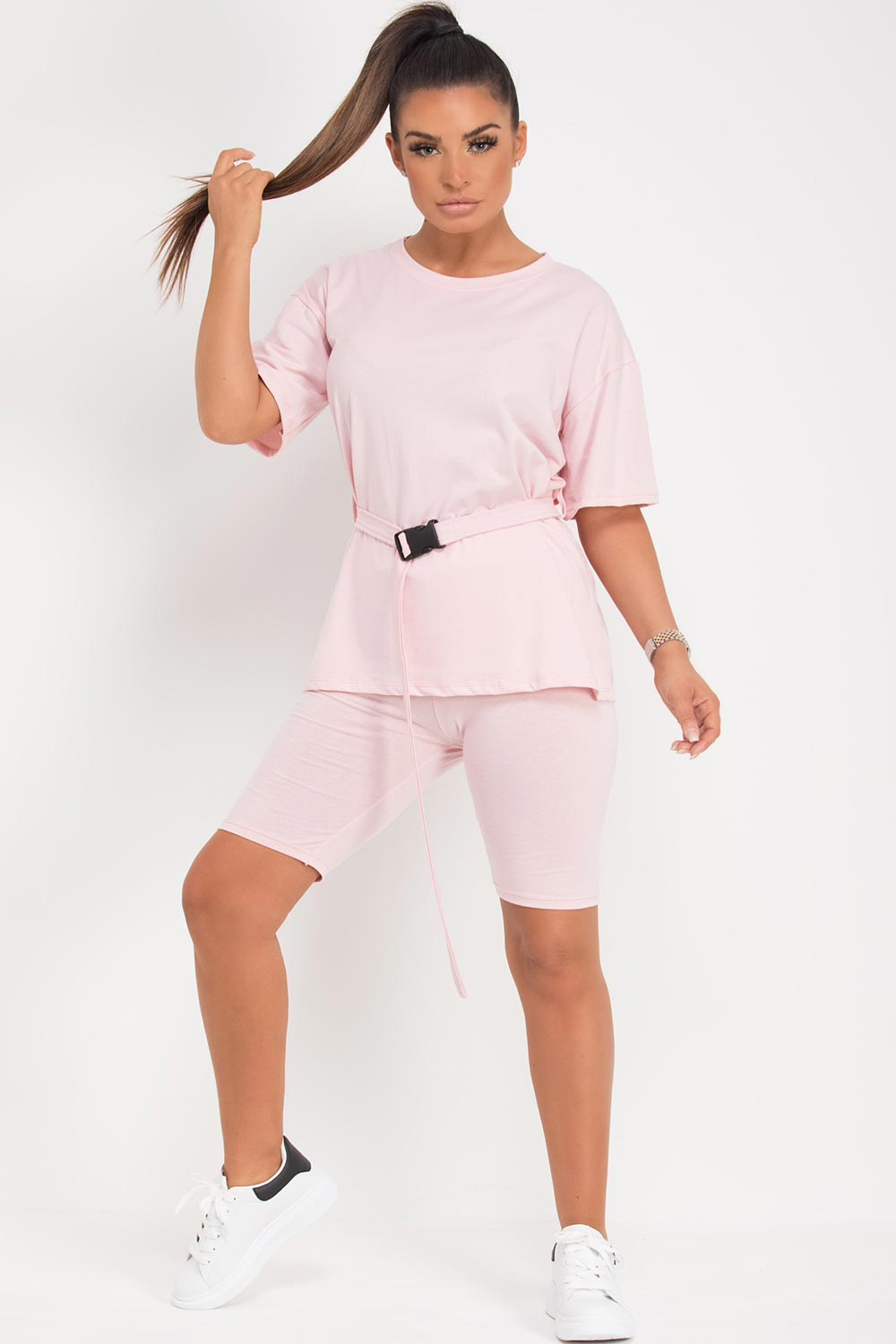 pink cycling shorts and top set with utility belt