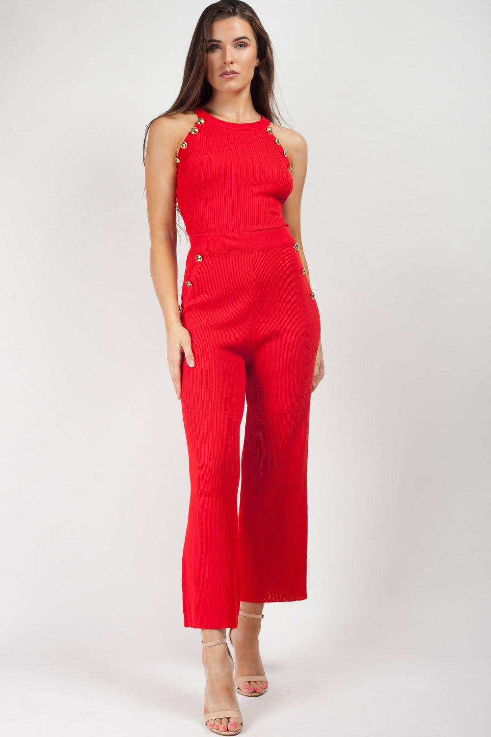 red knitted loungewear set with gold buttons