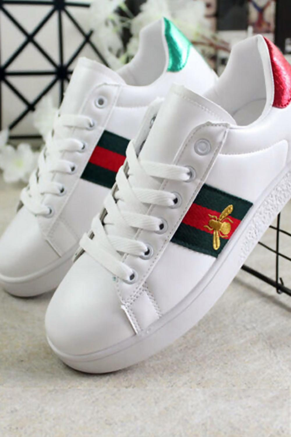 red and green stripe trainers