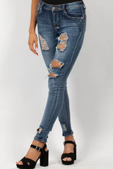 Distressed Mid Wash Blue Skinny Jeans