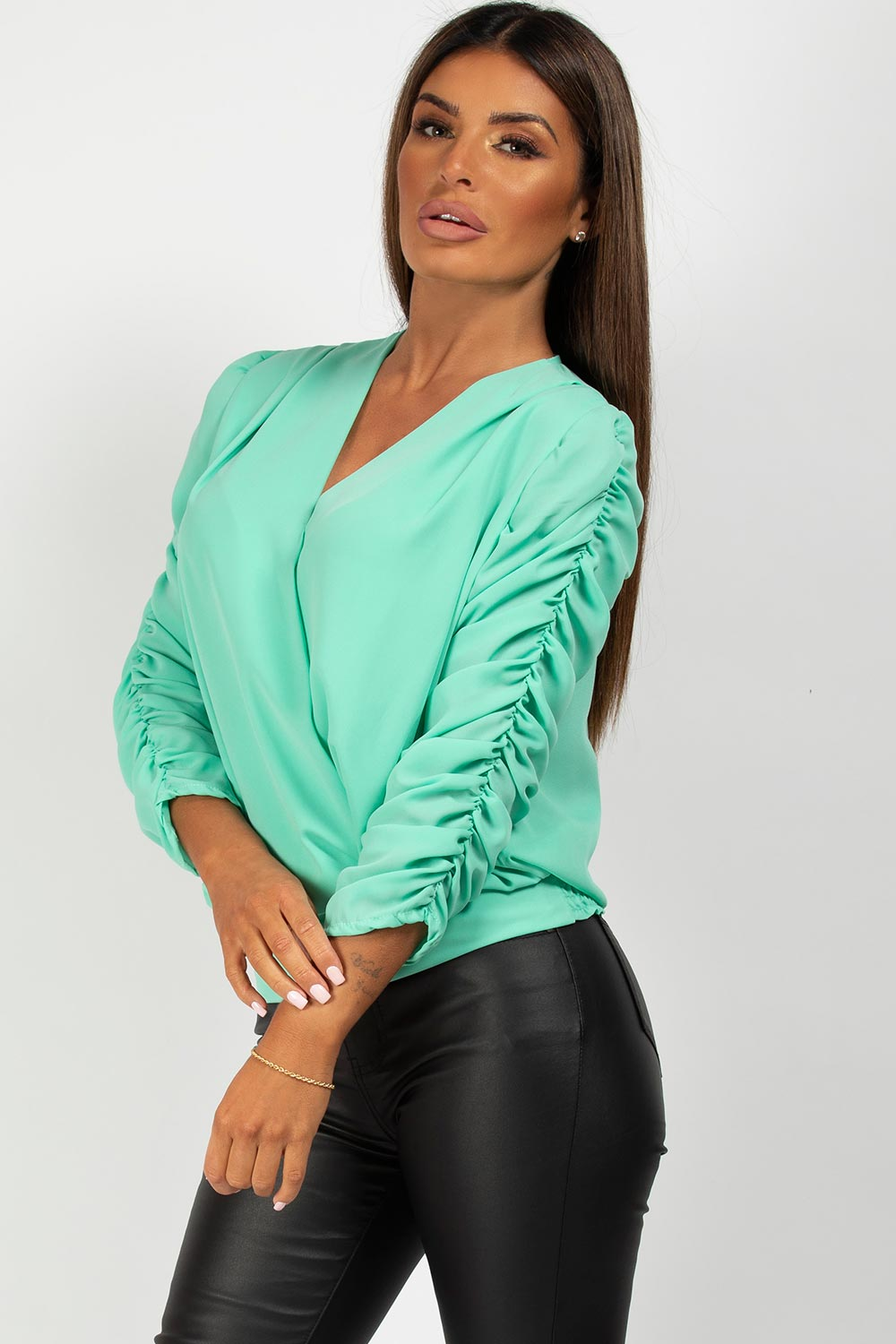mint wrap over long sleeve blouse