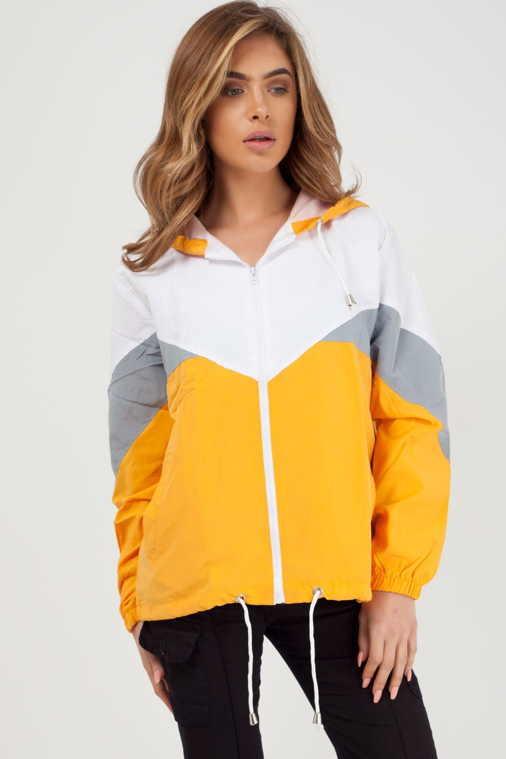 mustard windbreaker jacket styledup fashion