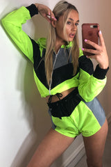 neon green colour block hooded shell suit