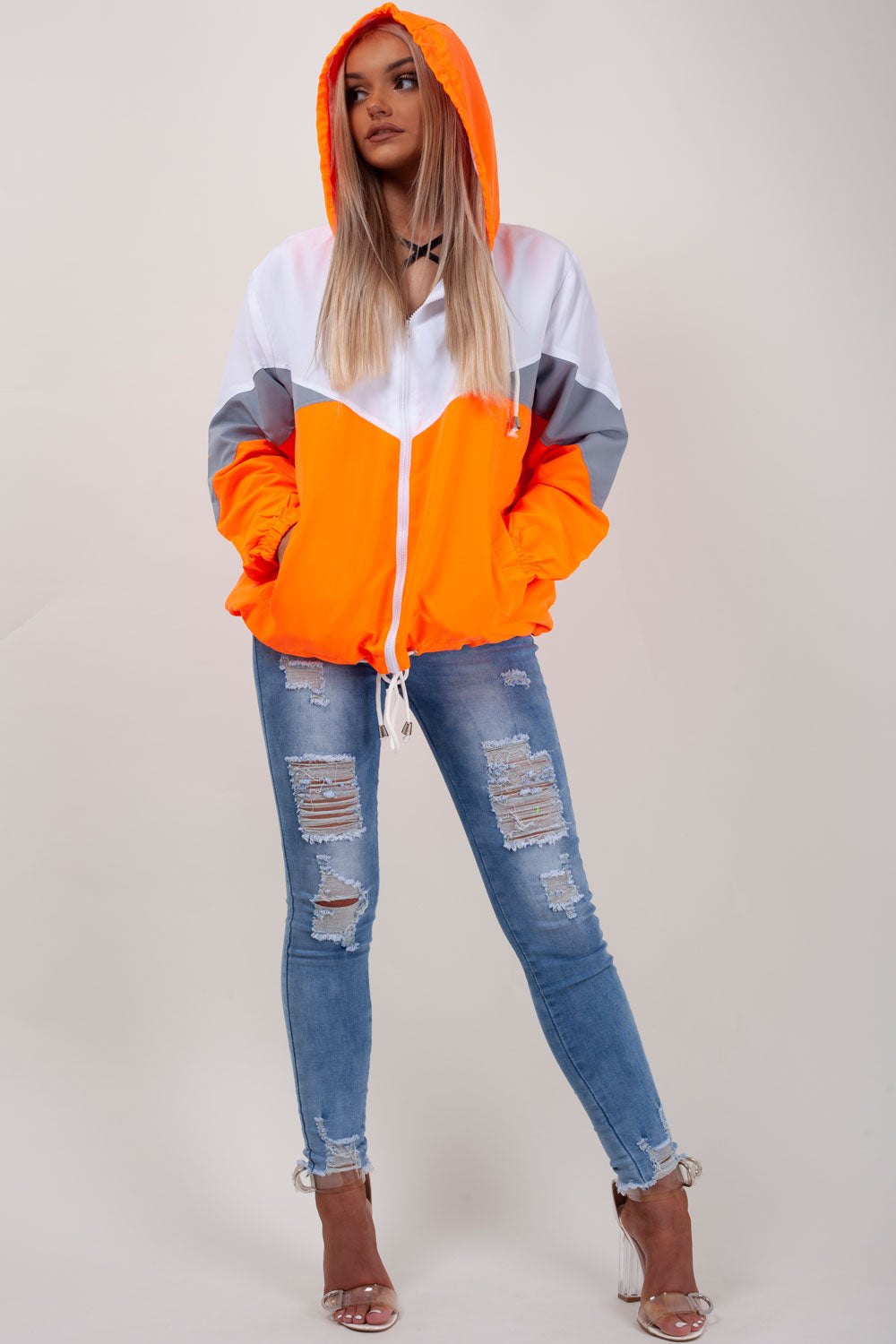 neon orange hooded paneled windbreaker
