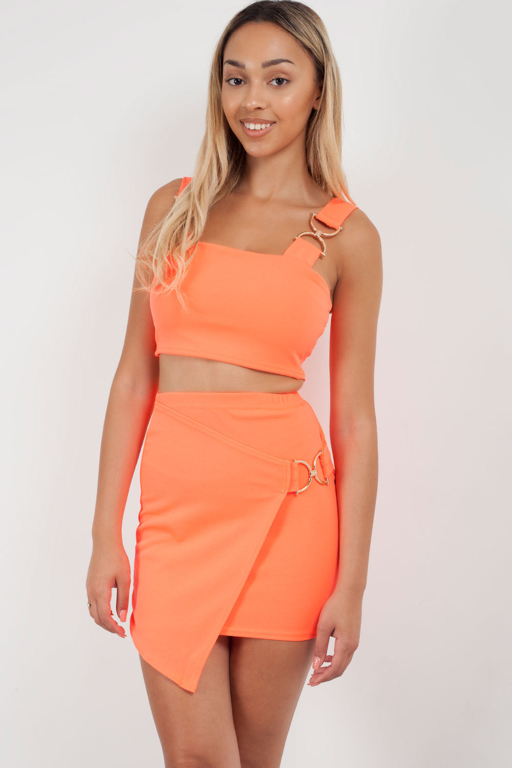 neon orange mini skirt and crop top set