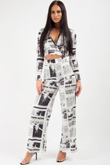 black white newspaper print straight leg trousers